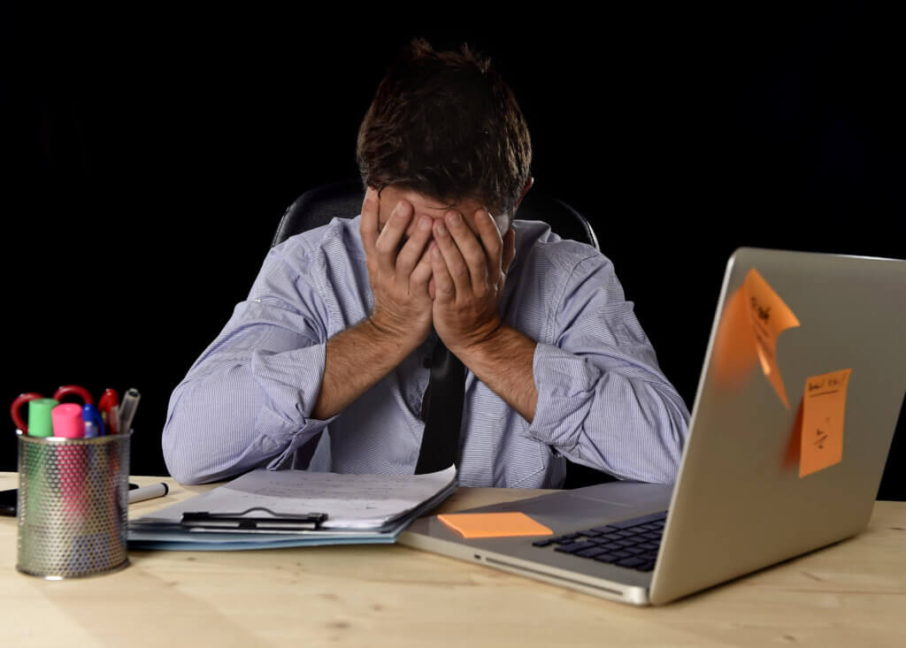 tired businessman suffering work stress wasted worried busy in office late at night with laptop computer