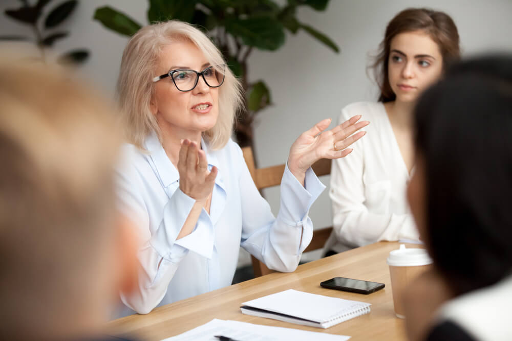 Business woman talking at a meeting